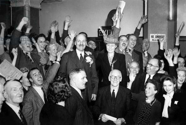 New Prime Minister Clement Attlee celebrates with supporters after labour's surprise victory in the General Election.
