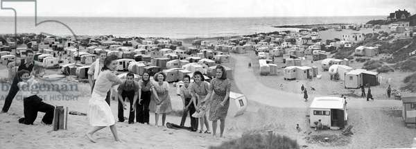 Men and Women play a game of Cricket on the Beach, July 1948 (b/w photo)