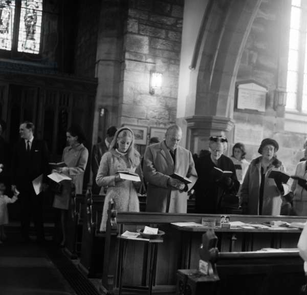 The Christening of Jennie Churchill, Newick Parish Church. Jennie Churchill daughter of Winston S. Churchill (Randolph's son and Grandson of Winston Churchill). Present were Lady Churchill, her son Randolph Churchill and his daughter Arabella. The Godfather was Mr Simon Ingall, and Lady Digby, mother of Mrs Winston Churchill. 12th March 1967 (b/w photo)
