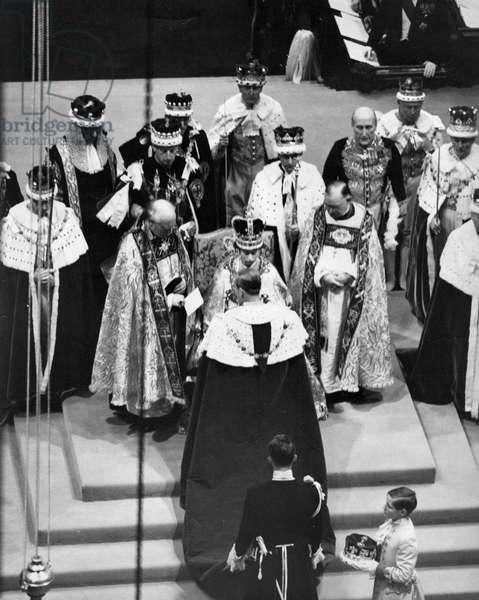 Queen Elizabeth II, Princess Elizabeth - Coronation The Duke of Edinburgh paying homage to his wife the new Queen, 1950 (b/w photo)
