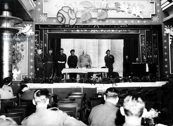 British Prime Minister Winston Churchill making an emotional speech at the Winston Club for British troops on the Kurfurstendamm in Berlin, Germany at the end of the Second World War, July 1945 (b/w photo)