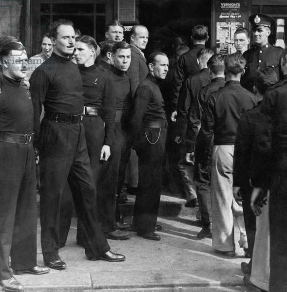William Joyce (left) Sir Oswald Mosley (second left) among fascists at the Haymarket, Newcastle following a rally on the Town Moor, July 1934 (b/w photo)