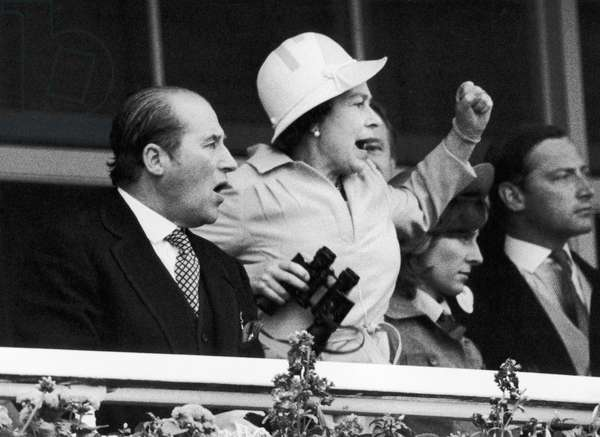 The Queen and her racing manager Lord Porchester watch the finish of the 1978 Epsom Derby, 8th June 1978 (b/w photo)