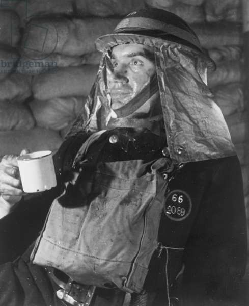 A firefighter takes a well earned break for a cup of tea after attending to many bombed buildings duriign the blitz in March 1942 (b/w photo)
