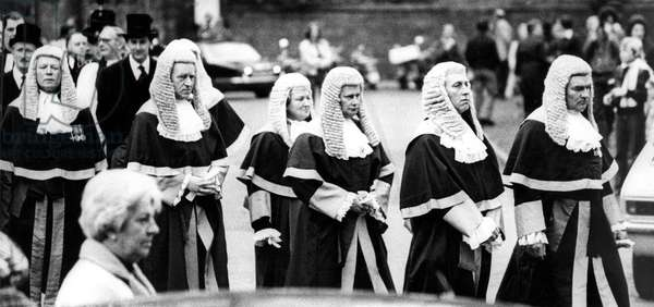 """Solemn faced judges wind their way from Durham Castle to the Cathedral in the annual """"Procession of Judges"""" in May 1977 (b/w photo)"""