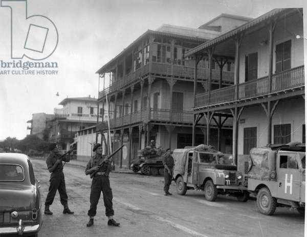 The Suez crisis - Troops on the alert for snipers as the army convoys drive through the streets of Port Said, 08/11/1956 (b/w photo)