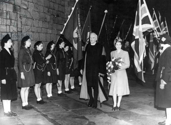 Queen Elizabeth II, Princess Elizabeth visits Durham with the Dean of Durham, Dr Alington, passing a guard of honour formed by girl guides in the Cloisters of Durham Cathedral, 23/10/1947
