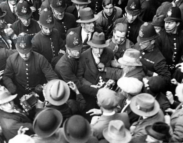 FA Cup Final at Wembley Stadium. Cardiff City 1 v Arsenal 0. Cardiff captain Fred Keenor is escorted through the crowd on his way to the team bus. Directly behind him is Jimmy Nelson and Len Davies.  23rd April 1927.