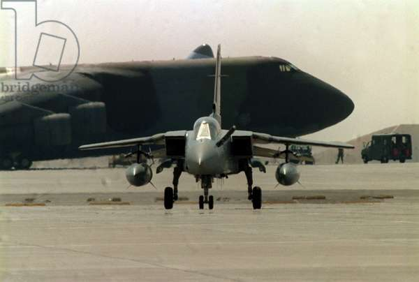 An RAF Tornado F3 fighter taxi's in in front of a USAF Galaxy transport aircraft in Dhahran, 1990 (photo)