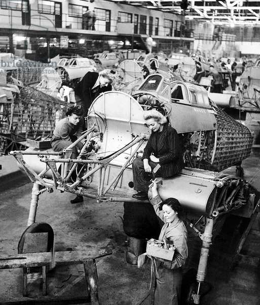Women work on the production line of Hawker Hurricane aircraft during WW2, c. 1942 (b/w photo)