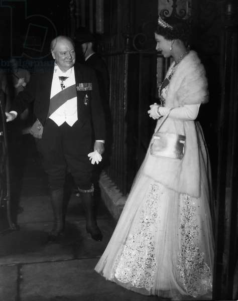 Winston Churchill escorts Queen Elizabeth to her car after dining at no 10 Downing Street, April 1955 (b/w photo)