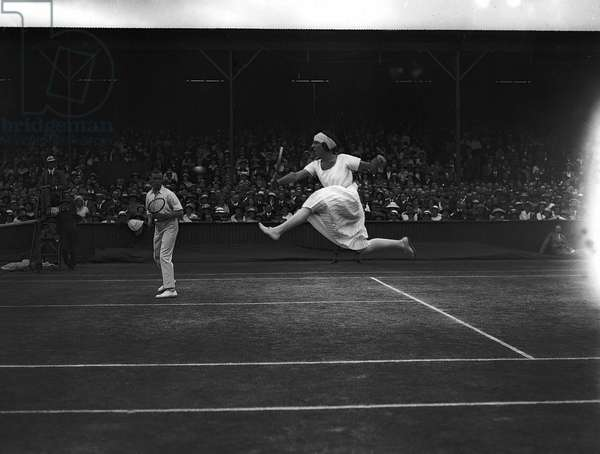 Mlle Suzanne Lenglen and G L Patterson in the mixed doubles at the Tennis Championships Wimbledon 1923 (b/w photo)