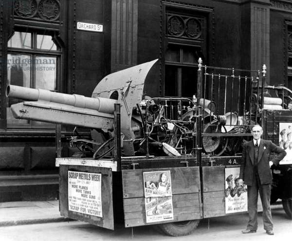 A First World War artillery gun was among a lorry load of scrap metal which toured Newcastle in conjunction with Salvage Week during the Second World War, 8th July 1940 (b/w photo)