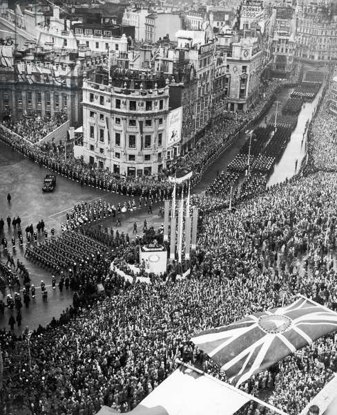 The Coronation of Queen Elizabeth II was the ceremony in which the newly ascended monarch, Elizabeth II, was crowned Queen of the United Kingdom, Canada, Australia, New Zealand, South Africa, Ceylon, and Pakistan, as well as taking on the role of Head of the Commonwealth. (Picture) General view of the huge crowds in Trafalgar Square, watching Commonwealth troops in the Coronation Procession on their way back from Westminster Abbey to Buckingham Palace. 2nd June 1953 (b/w photo)