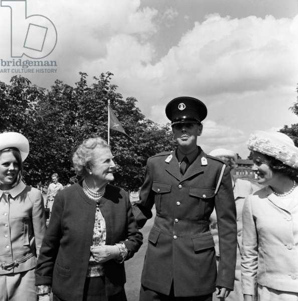 Field Marshal Lord Montgomery today inspected the passing out parade of officer cadets at Le Mons Officer Cadet School at Aldershot. Among the many cadets receiving their commissions today was officer cadet Nicholas Soames, the grandson of the late Sir Winston Churchill. His grandmother Lady Spencer Churchill was among those present to watch the proceedings, she arrived with her daughter Mrs Mary Soames and the Rt. Hon. Mr Christopher Soames. Pictured, Nicholas Soames, with his grandmother Lady Spencer Churchill. 4th August 1967 (b/w photo)