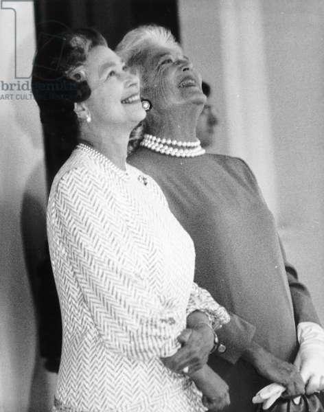 First Lady Barbara Bush shares a joke with Queen Elizabeth II, 1989 (b/w photo)