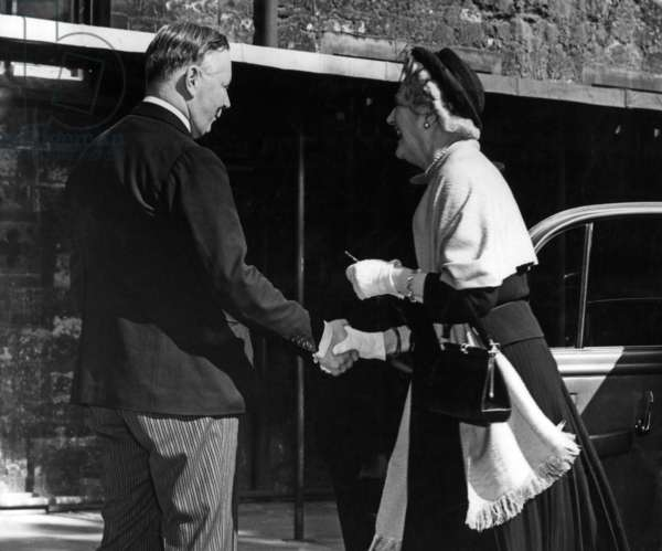 Lady Churchill greeted by the Duke of Norfolk on her arrival at Westminster Abbey for a Coronation rehearsals. 20th May 1953 (b/w photo)