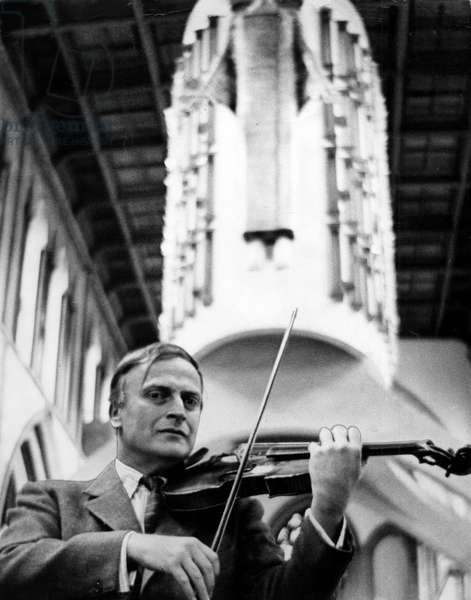 Yehudi Menuhin - Famous concert violinist pictured at Llandaff Cathedral, Cardiff, where he performed with the Bath Festival Chamber Orchestra. Behind him is Epstein's Christ in Majesty, 20th June 1964 (b/w photo)