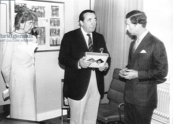 Robert Maxwell presenting Prince Charles with at gift Princess Diana watching at the Commonwealth games in 1986