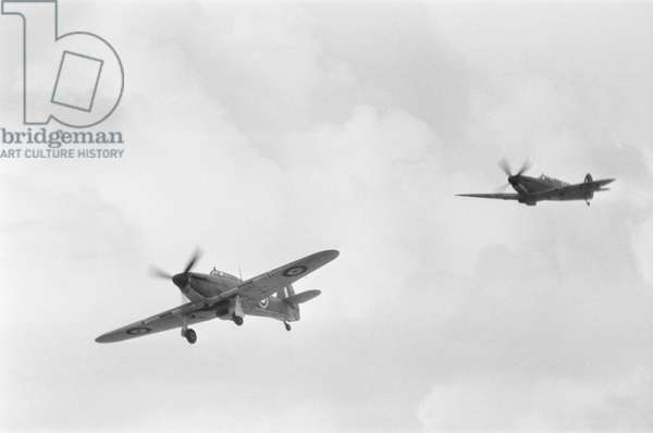 Hawker Hurricane (left) and a Supermarine Spitfire seen here taking part in the fly past at RAF Scampton, Lincoln. Were there was a ceremony to mark the shut down of Bomber Command. April 29th 1968