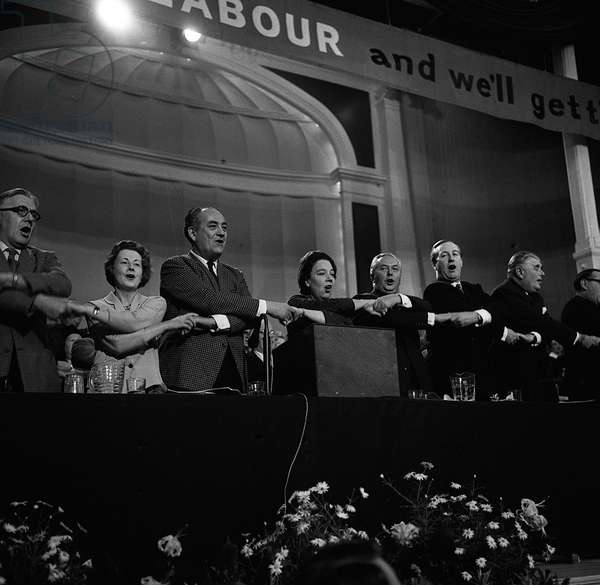 Harold Wilson leading his colleagues Dick Crossing, Barbara Castle, Tom Dribers, Alice Bacon and Anthony Greenwood in a hearty rendition of Auld Lang Syne at the end of the Labour Party Conference in 1963 (b/w photo)