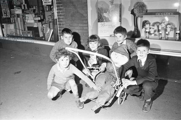 """""""Penny for the guy."""" Children on the streets of Reading collecting money with their """"Guy"""" For bonfire night, 4th November 1970 (b/w photo)"""