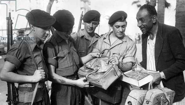 The Suez crisis - British troops go Christmas shopping in Port Said and barter in street, 28/11/1956 (b/w photo)