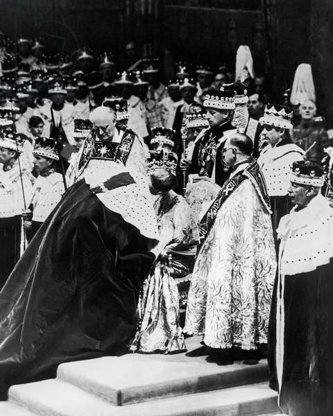 Coronation of Queen Elizabeth II- Duke of Edinburgh is here seen kissing the Queen in homage on the day of her Coronation. 2nd June 1953 (b/w photo)