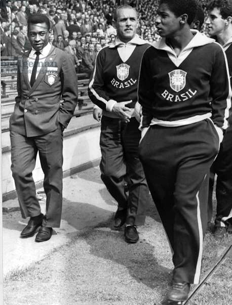 Pele Brazilian football player (L) in team blazer with fellow players 1966 (photo)