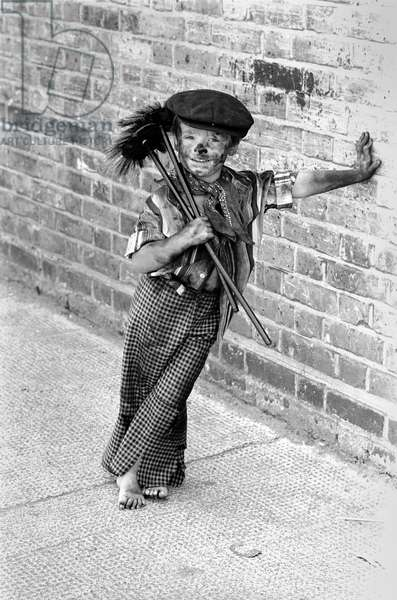 Tommy Stafford dressed as a chimney sweeper at the East End Market 100 years Celebrations, August 1980 (b/w photo)