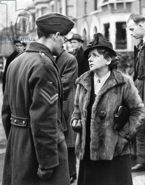Miss Ellen Wilkinson gives her sympathies to Corporal Biddle, after an daylight air raid during the Second World War, 1943 (b/w photo)