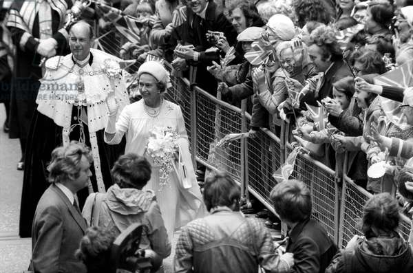 Queen Elizabeth II waving at the crowd during their Silver Jubilee celebrations, June 1977 (b/w photo)