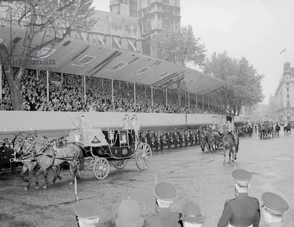 The Coronation of Queen Elizabeth II. A horse drawn carriage, part of the procession leaving Westminster Abbey after the ceremony. 2nd June 1953 (b/w photo)