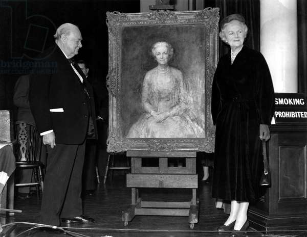 The presentation of Lady Churchill's portrait to the Prime Minister, Sir Winston Churchill by his constituency at Woodford. The painting was to be on public view for a few weeks afterwards. The portrait was to form a double celebration gift, for both Sir Winston's 80th birthday on November 30th and his 30 years as an MP for the division . 23rd November 1954 (b/w photo)