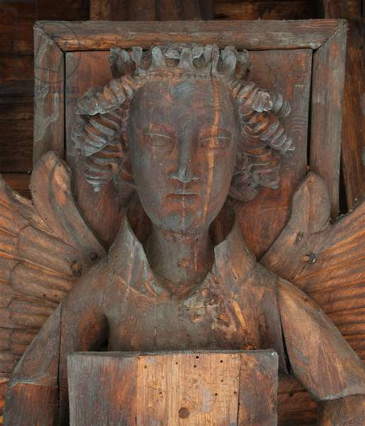 Face of crowned angel bearing a book. South side of roof, St. Nicholas, Kings Lynn, Norfolk, c.1400-10 (photo)