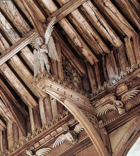 The angel roof at St. Agnes, Cawston, Norfolk: angel standing on end of hammer beam, 15th century (photo)
