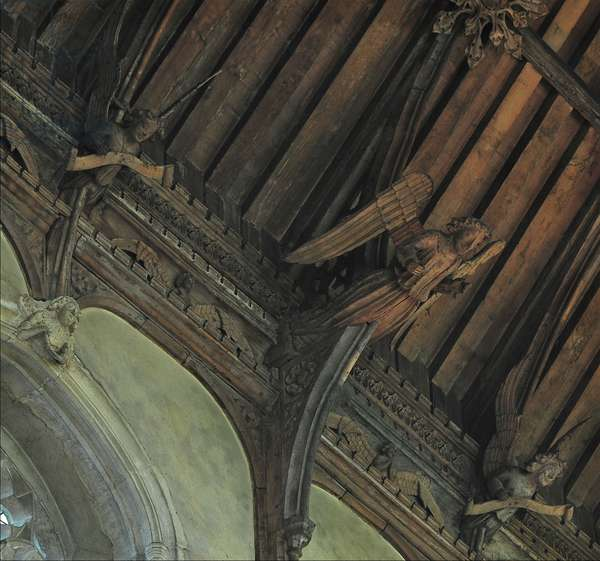 Hammer beam angel flanked by demi angels on the wall plate at Wymondham Abbey, Norfolk, c.1445 (photo)
