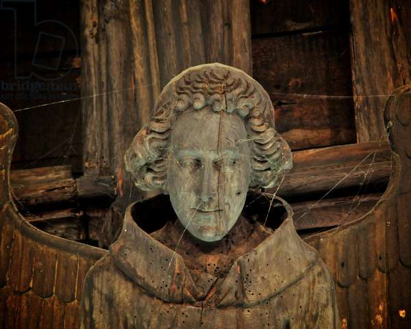 Close up of the face of a roof angel from St. Mary's, Bury St. Edmunds, Suffolk, Mid 15th century (photo)