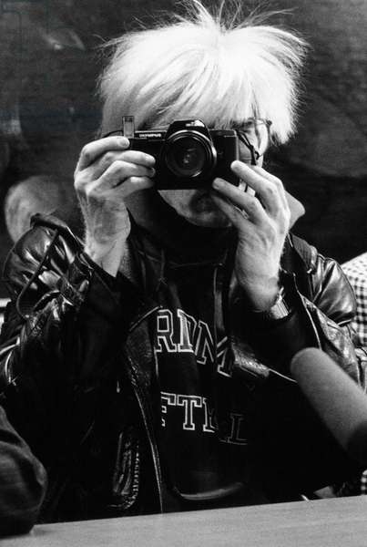 """Andy Warhol and Maria Mulas photographing each other at the Stelline Foundation, on the occasion of Warhol's exhibition """"Il cenacolo"""", Milan, Italy, 1987 (b/w photo)"""