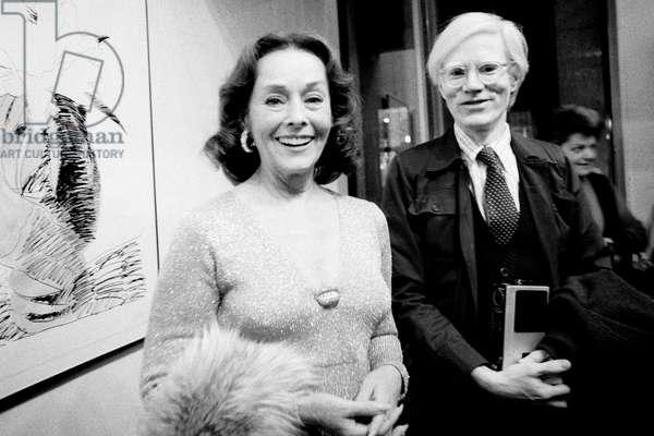 Paulette Goddard and Andy Warhol, Milan, Italy 1974 (b/w photo)