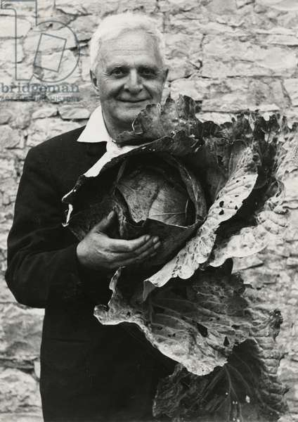 Sir Stephen Spender with a Cabbage (b/w photo)