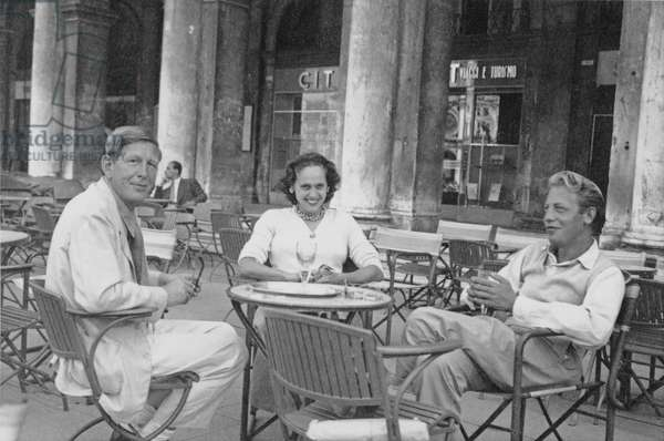 W. H. Auden, Natasha Spender and Chester Kallman at the PEN Conference in Venice, sitting outside Caffe Florian in Piazza San Marco, 1949 (b/w photo)