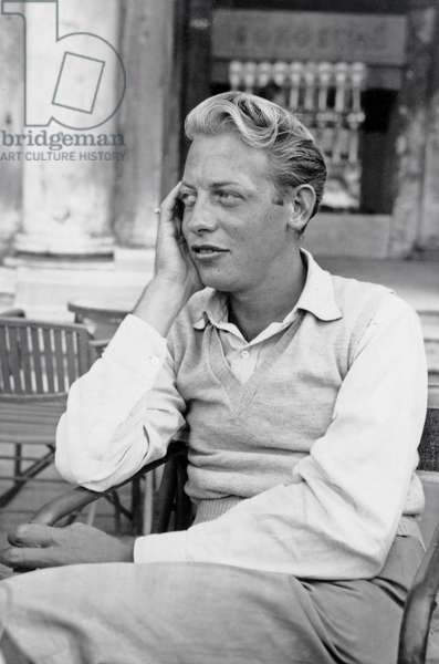 Chester Kallman at the PEN Conference in Venice, sitting outside Caffe Florian in Piazza San Marco, 1949 (b/w photo)