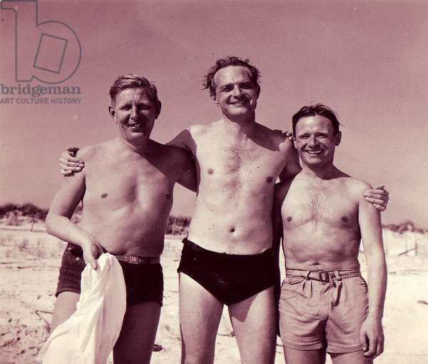 W.H. Auden, Stephen Spender and Christopher Isherwood, photographed at the beach on Fire Island, New York, in 1947, by their friend Lincoln Kirstein (b/w photo)