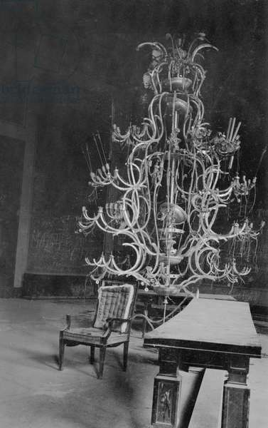 One of the giant chandeliers in the ruins of Hitler's Reich Chancellery, Berlin, July 1945 (b/w photo)