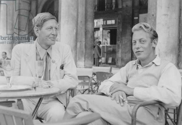 W. H. Auden and Chester Kallman at the PEN Conference in Venice, sitting outside Caffe Florian in Piazza San Marco, 1949 (b/w photo)