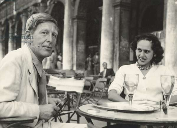 W. H. Auden and Natasha Spender at the PEN Conference in Venice, sitting outside Caffe Florian in Piazza San Marco, 1949 (b/w photo)