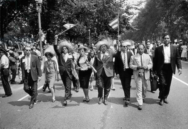 The March on Washington: Marchers Wearing Hats Carry Puerto Rican Flags Down Constitution Avenue, 29th August 1963 (b/w photo)