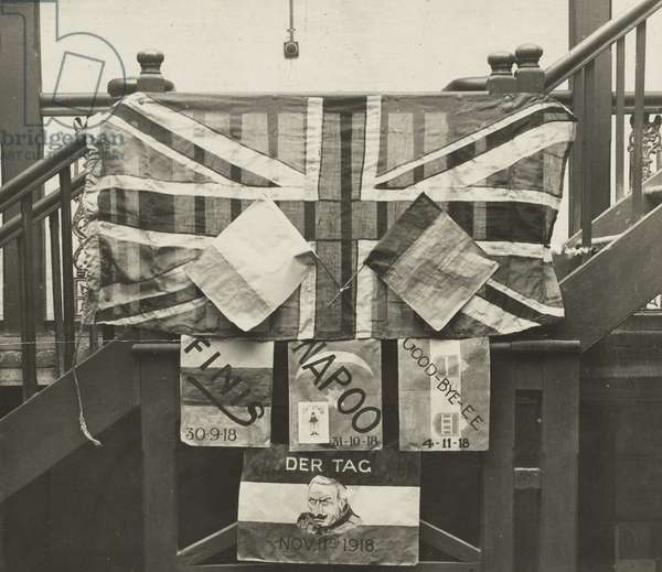 Flags posted up on the stairs at G.H.Q. Baghdad on Armistice Day, 11th Nov 1918 (b/w photo)