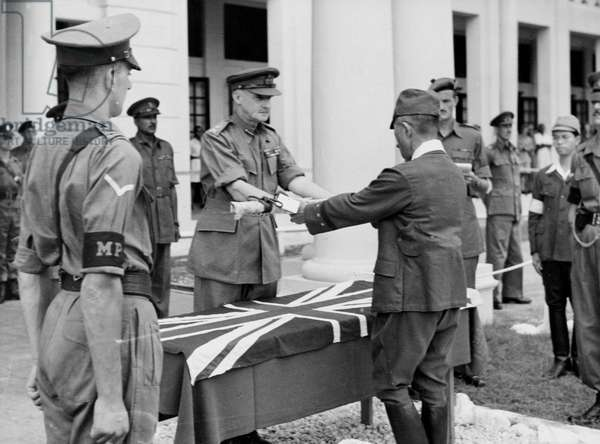 The formal surrender by Japanese General Itagahi Seishiro of his sword, Kuala Lumpur, 1946, from an official collection of photos from the Middle and Far East during World War Two compiled by Major General Messervy (b/w photo)